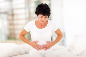 mid age woman having stomach pain